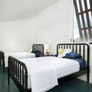 Design ideas for a country gender neutral children's room in Austin with white walls, painted wood flooring and green floors.
