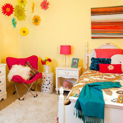 Kids' room - mid-sized traditional girl carpeted kids' room idea in Dallas with yellow walls