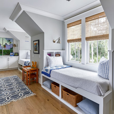 Inspiration for a coastal gender-neutral medium tone wood floor and brown floor kids' room remodel in Charleston with gray walls