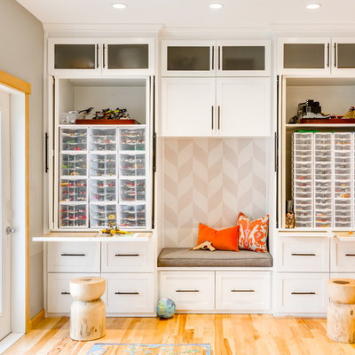 Example of a transitional gender-neutral light wood floor playroom design in Seattle with gray walls