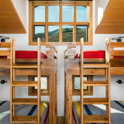 Mountain style gender-neutral kids' bedroom photo in Denver with white walls