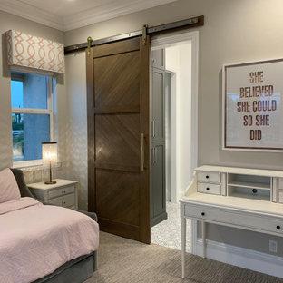 На фото: маленькая детская в современном стиле с спальным местом, серыми стенами, мраморным полом и серым полом для девочки с