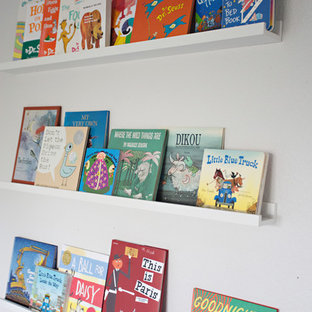 Inspiration for a mid-sized eclectic boy carpeted kids' bedroom remodel in San Diego