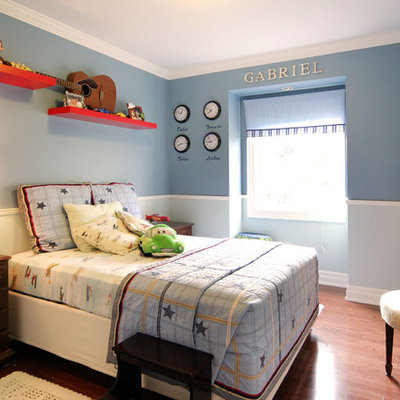 Trendy boy kids' room photo in Toronto with blue walls