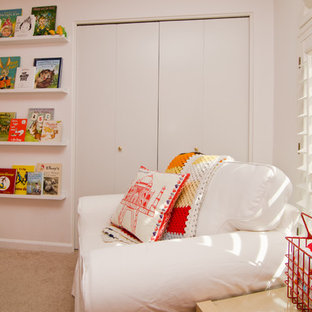 Example of a mid-sized minimalist gender-neutral carpeted kids' room design in Phoenix with white walls