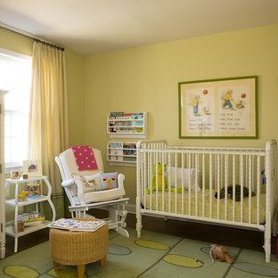 Example of a cottage chic girl dark wood floor toddler room design in DC Metro with yellow walls