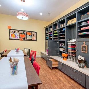 Inspiration for a large timeless gender-neutral medium tone wood floor kids' room remodel in St Louis with yellow walls