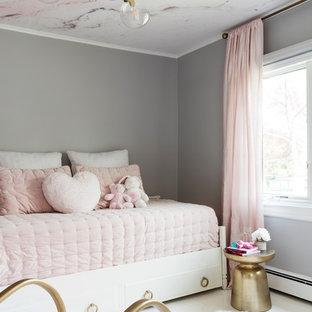 Imagen de dormitorio infantil de 1 a 3 años, tradicional renovado, pequeño, con paredes grises, suelo de madera pintada y suelo blanco
