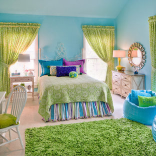 Example of a mid-sized classic girl carpeted kids' room design in New York with blue walls