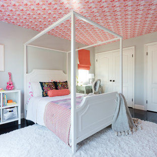 Inspiration for a large transitional girl dark wood floor kids' bedroom remodel in Los Angeles with gray walls