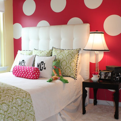 Inspiration for a contemporary girl carpeted kids' room remodel in Charlotte with multicolored walls
