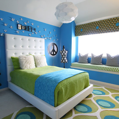 Kids' room - contemporary girl carpeted kids' room idea in Dallas with blue walls