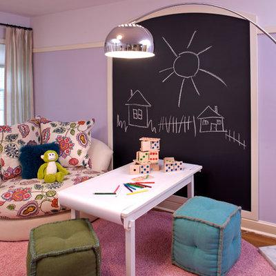 Trendy gender-neutral medium tone wood floor kids' room photo in Minneapolis with purple walls