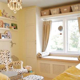 Small trendy gender-neutral kids' room photo in Toronto with yellow walls