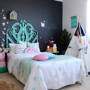 This is an example of an eclectic kids' room for kids 4-10 years old and girls in Perth with carpet and multi-coloured walls.