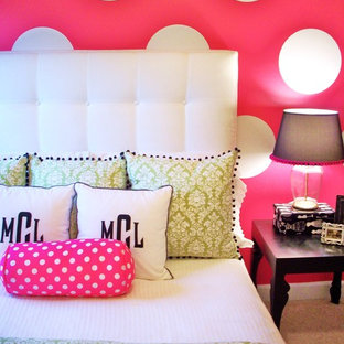 Inspiration for a contemporary girl carpeted kids' room remodel in Charlotte with pink walls