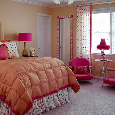 Example of a classic girl carpeted kids' bedroom design in Atlanta with orange walls