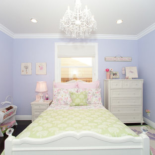 Example of a classic girl kids' room design in Los Angeles with purple walls