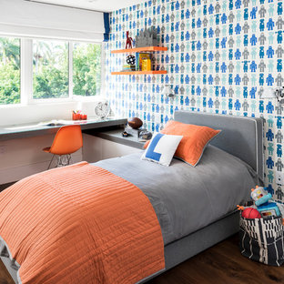 Contemporary kids' room in Miami with multi-coloured walls and dark hardwood floors for boys.