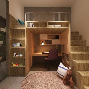Foto di una cameretta per bambini design di medie dimensioni con pareti beige