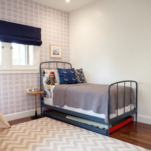 Example of a mid-sized trendy boy medium tone wood floor kids' room design in San Francisco with multicolored walls
