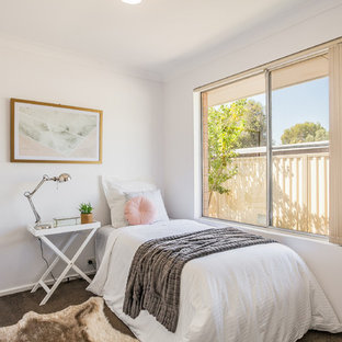 This is an example of a contemporary kids' room for girls in Perth with white walls, carpet and grey floor.