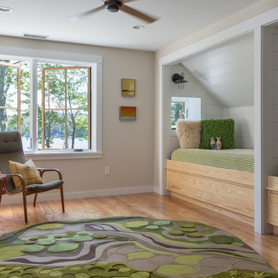 Inspiration for a mid-sized transitional gender-neutral light wood floor and brown floor kids' room remodel in Portland Maine with beige walls