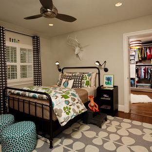 Kids' room - traditional gender-neutral dark wood floor and brown floor kids' room idea in DC Metro with gray walls