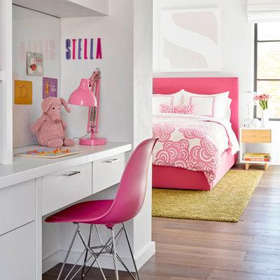 Large trendy girl dark wood floor kids' room photo in Dallas with white walls