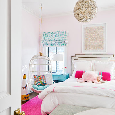 Example of a transitional girl kids' room design in Dallas with pink walls