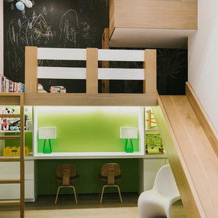 Inspiration for a large contemporary gender-neutral light wood floor and beige floor kids' room remodel in New York with black walls
