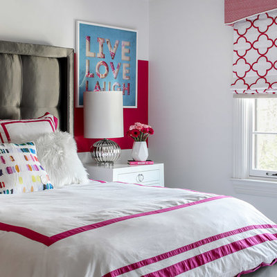 Inspiration for a mid-sized transitional girl dark wood floor and brown floor kids' room remodel in New York with pink walls