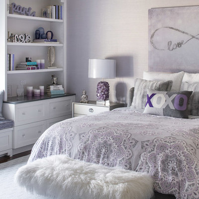 Example of a mid-sized transitional girl dark wood floor and brown floor kids' room design in New York with purple walls