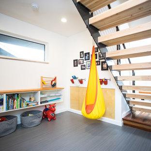 Idee per una cameretta per bambini da 1 a 3 anni moderna di medie dimensioni con pareti bianche e pavimento in linoleum