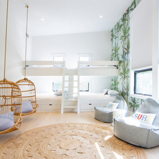 Inspiration for a coastal gender-neutral light wood floor and beige floor kids' room remodel in New York with multicolored walls