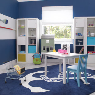 This is an example of a small classic gender neutral kids' room in Miami with blue walls and porcelain flooring.