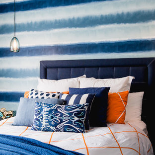 Photo of a mid-sized contemporary gender-neutral teen room in Melbourne with blue walls and carpet.