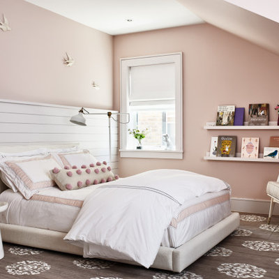 Inspiration for a large transitional girl medium tone wood floor and brown floor kids' room remodel in Los Angeles with pink walls
