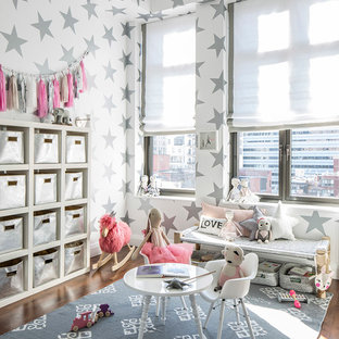 Example of a mid-sized trendy girl medium tone wood floor kids' room design in New York with multicolored walls