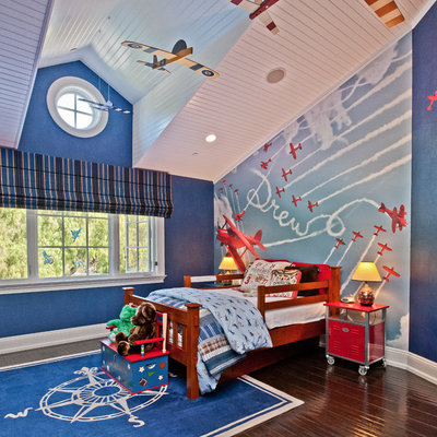 Example of a classic boy kids' room design in Los Angeles with multicolored walls