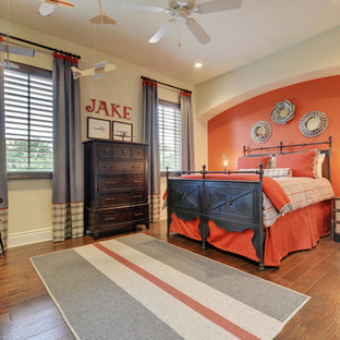 Inspiration for a transitional boy medium tone wood floor kids' room remodel in Austin with multicolored walls