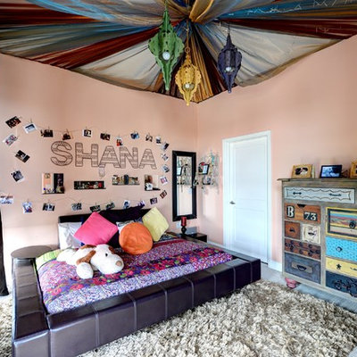 Inspiration for a mid-sized eclectic girl carpeted and gray floor kids' room remodel in Atlanta with pink walls