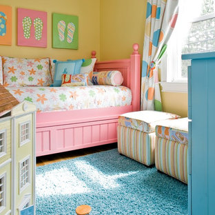 Inspiration for a large timeless girl carpeted kids' room remodel in Boston with yellow walls