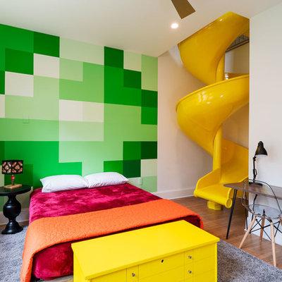 Kids' bedroom - mid-sized contemporary medium tone wood floor and brown floor kids' bedroom idea in Austin with green walls