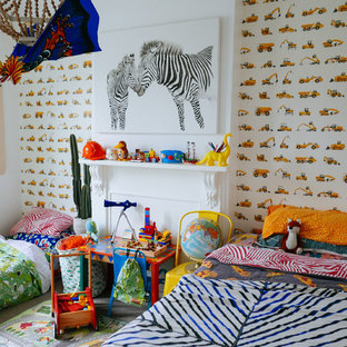 Bohemian toddler's room for boys in Sydney with white walls and carpet.