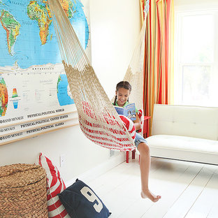 Example of a cottage kids' room design in Columbus with white walls