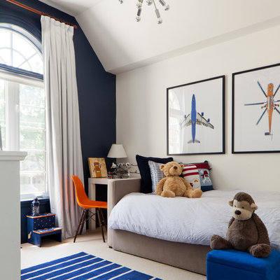 Inspiration for a transitional boy carpeted kids' room remodel in Toronto with white walls