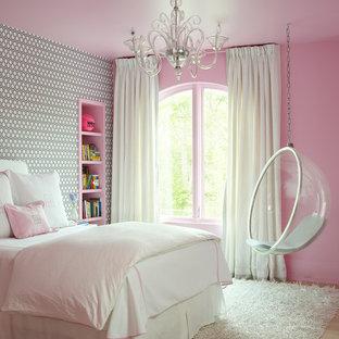 Elegant girl light wood floor kids' bedroom photo in Houston with multicolored walls