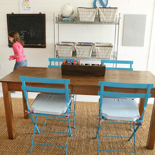 Farmhouse gender-neutral kids' study room photo in Columbus with white walls