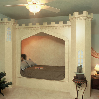 Example of a large classic boy carpeted kids' bedroom design in Houston with blue walls